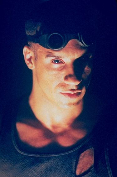 Vin as Riddick looking menacing in Pitch Black